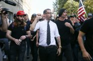 Proud Boys founder Gavin McInnes pumps his fist during a rally at Martin Luther King Jr. Civic Center Park on April 27, 2017 in Berkeley, Calif. Protesters marched in opposition to the cancellation of a speech by American conservative political commentator Ann Coulter at the University of California-Berkeley. Photo by Elijah Nouvelage/Getty Images.