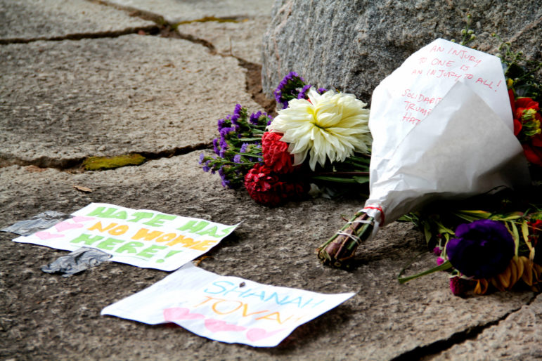 Flowers are left at the site of anti-Jewish and pro-Donald Trump graffiti that was spray painted near the Gates of Heaven synagogue in Madison, Wis. The graffiti were found hours before worshipers celebrated Rosh Hashanah, the Jewish New Year, on Sept. 20. Photo by Alexandra Hall / WPR/Wisconsin Center for Investigative Journalism.