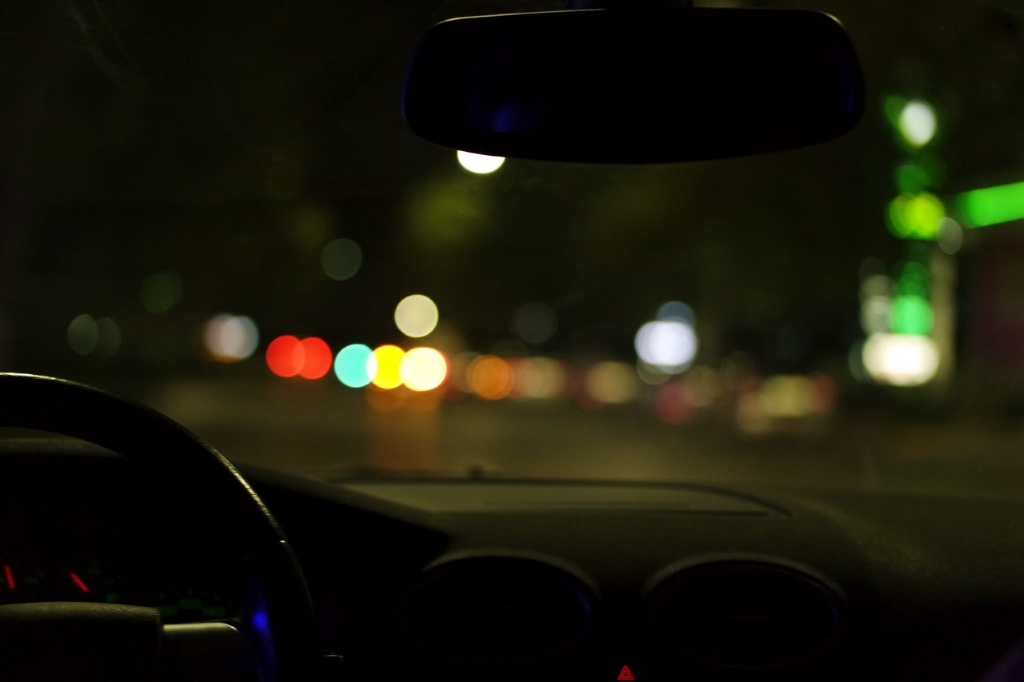 Driving after dark. Photo is in the Public Domain.