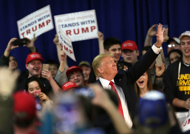 Donald Trump waves to fans after entering a town hall event in Rothschild, Wis., April 2, 2016. Trump's anti-Muslim and tough-on-immigration rhetoric is being blamed for a rise in white supremacist and other hate groups. Photo by Jacob Byk / USA TODAY NETWORK - Wisconsin.