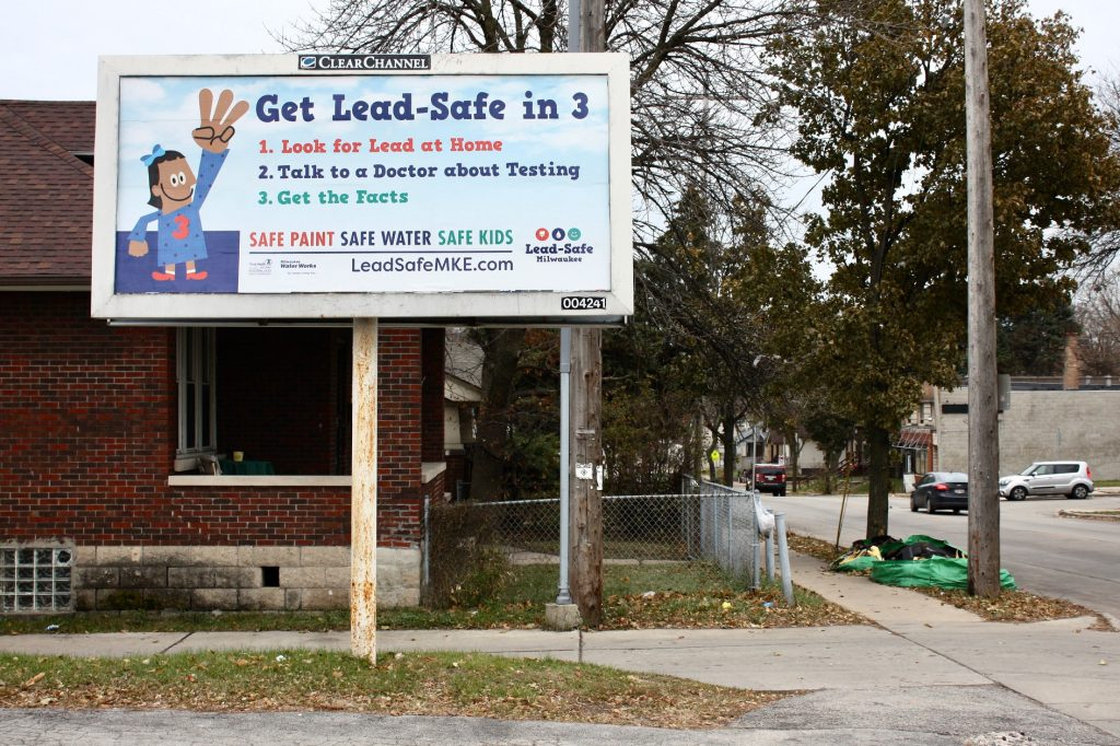 A billboard near North 5th Street and West Keefe Avenue is intended to raise awareness about lead exposure. Photo by Jabril Faraj.