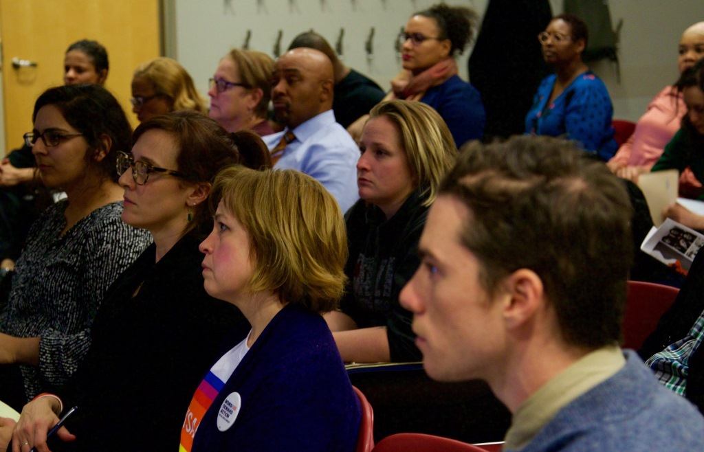 About 25 community members gathered at Washington Park Library to learn about the Blueprint for Peace. Photo by Leah Harris.