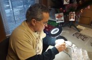 Chuck at his desk preparing eyeglasses for guests. Photo courtesy of the Nonprofit Center of Milwaukee.