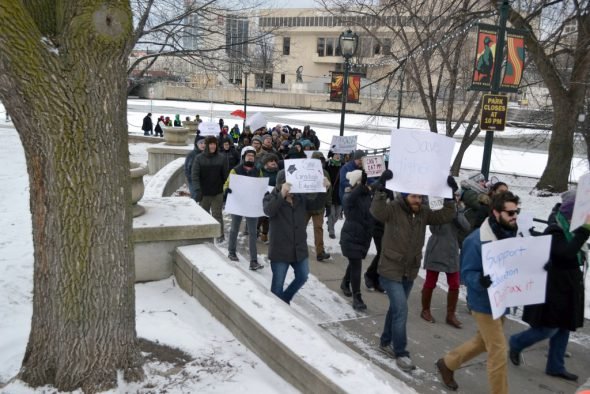 Grad students protest tax bill. Photo by Brad Poling.