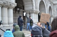 """""""No to excess tax on grad students our economy's future."""" Photo by Brad Poling."""