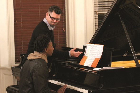 A faculty member working with a student in the Jazz Institute Honors Ensemble Program. Photo by Don Rebar.