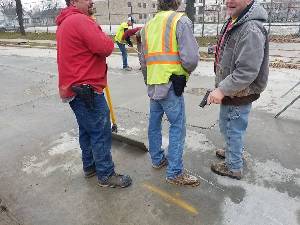 American Sewer Services employees displaying weapons. Photo posted by Brian Oliver.
