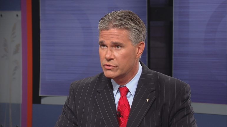"""When a state Department of Justice employee raised concerns about plans to send a security detail to the 2008 Republican National Convention for then-Attorney General J.B. Van Hollen, she says she faced retaliation. But the Wisconsin Supreme Court found Joell Schigur's expression of opinion about the legality of using taxpayer money for a political event did not qualify her for whistleblower protection. Van Hollen is pictured here during an appearance on Wisconsin Public Television's """"Here and Now"""" program on Sept. 21, 2012. Photo courtesy of """"Here and Now"""" / Wisconsin Public Television."""