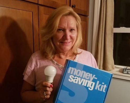 A Waukesha County participant shows off the energy-saving kit she ordered from Focus on Energy as part of the Cool Choices program. Photo from Cool Choices.
