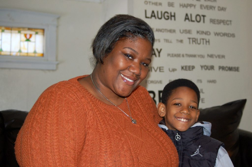 Hazel Blackmon and her son Mekhi, 7, pose at their home on North 23rd Street. Photo by Andrea Waxman.