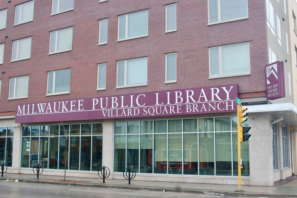 The Villard Square branch of the Milwaukee Public Library sits beneath 47 apartment units, some of which are affordable housing. The Northwest Side Community Development Corporation helped fund the building's construction. Photo by Elliot Hughes.