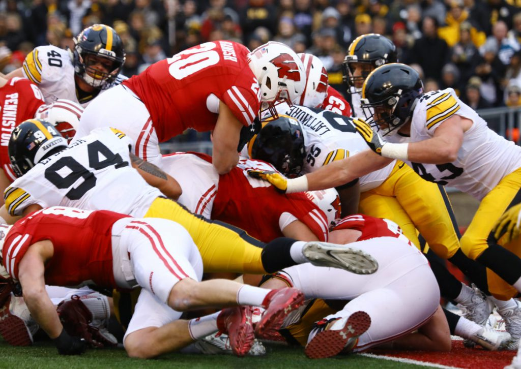 University of Wisconsin senior fullback Austin Ramesh, No. 20, suffered a concussion against Illinois and missed a week of practice on top of the next game against Indiana. As a fullback, Ramesh says he has become used to the violent collisions that occur every game. He is seen here at the Badgers' game against Iowa on Nov. 11, 2017. Brad Horn/For the Wisconsin Center for Investigative Journalism