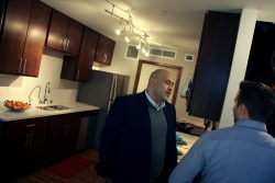 Ald. Jose Perez speaks with a visitor to one of the model townhouse apartments. (Photo by Jabril Faraj)