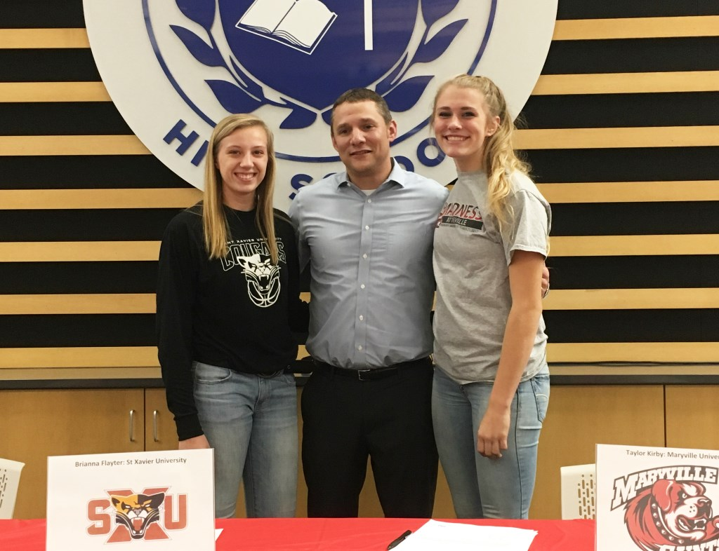 Brianna Flayter, Coach Brian Krysiak and Taylor Kirby. Photo courtesy of St. Thomas More High School.