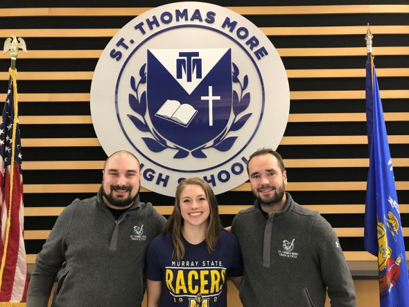 Coach Dan Steffes, Gabrielle Kennedy and Coach Griffin Loehner. Photo courtesy of St. Thomas More High School.