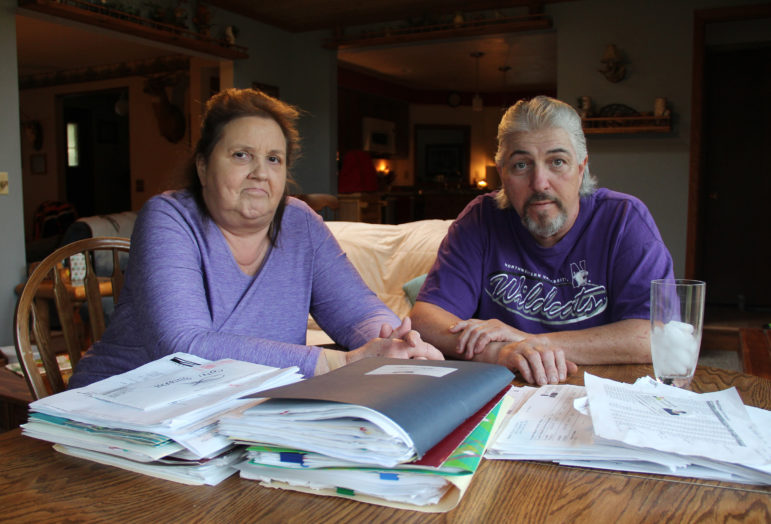 Richard Decker worked for more than 35 years for Kohler Co. before a brain injury sustained at work in 2010 forced him to stop working. Decker, seen here with his wife, Cathy, has problems with short-term memory and severe pain. Kohler has refused to provide him with long-term support under worker's compensation for the injury, and a state commission sided with the company. Photo by Alexandra Hall / WPR/Wisconsin Center for Investigative Journalism.