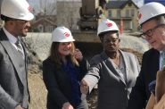 Developer Brandon Rule (left) shows Ellen Sexton of UnitedHealthcare, U.S. Rep Gwen Moore and WHEDA's Brian Schimming his project plans. Photo by Jeramey Jannene.