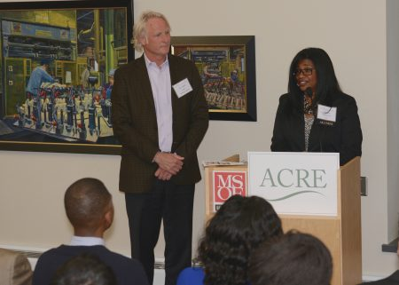 Donsia Strong Hill, LISC Milwaukee executive director, welcomes Mark Eppli at the ACRE graduation in 2016. Photo by Sue Vliet.