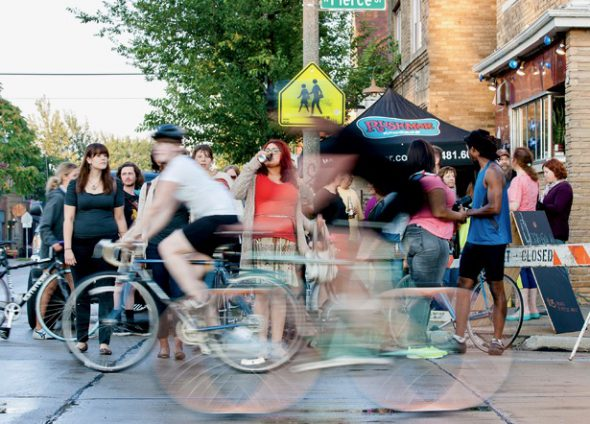Bikers whiz down Pierce Street during the annual Riverwest 24 ride. Photo courtesy of Sara Stathas.