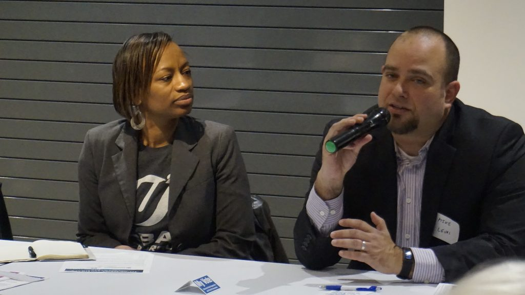 Panelists Sharlen Moore (left), executive director of Urban Underground, and Dr. Michael Levas, who specializes in pediatric emergency medicine at Children's Hospital of Wisconsin and the Medical College of Wisconsin, said gun violence affects everyone. Photo by Elizabeth Baker.