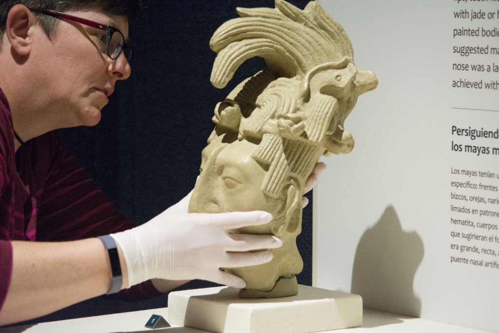 Rebecca Newberry, Conservator, the Science Museum of Minnesota, installs a Maya artifact from Mexico. Photo courtesy of the Milwaukee Public Museum.