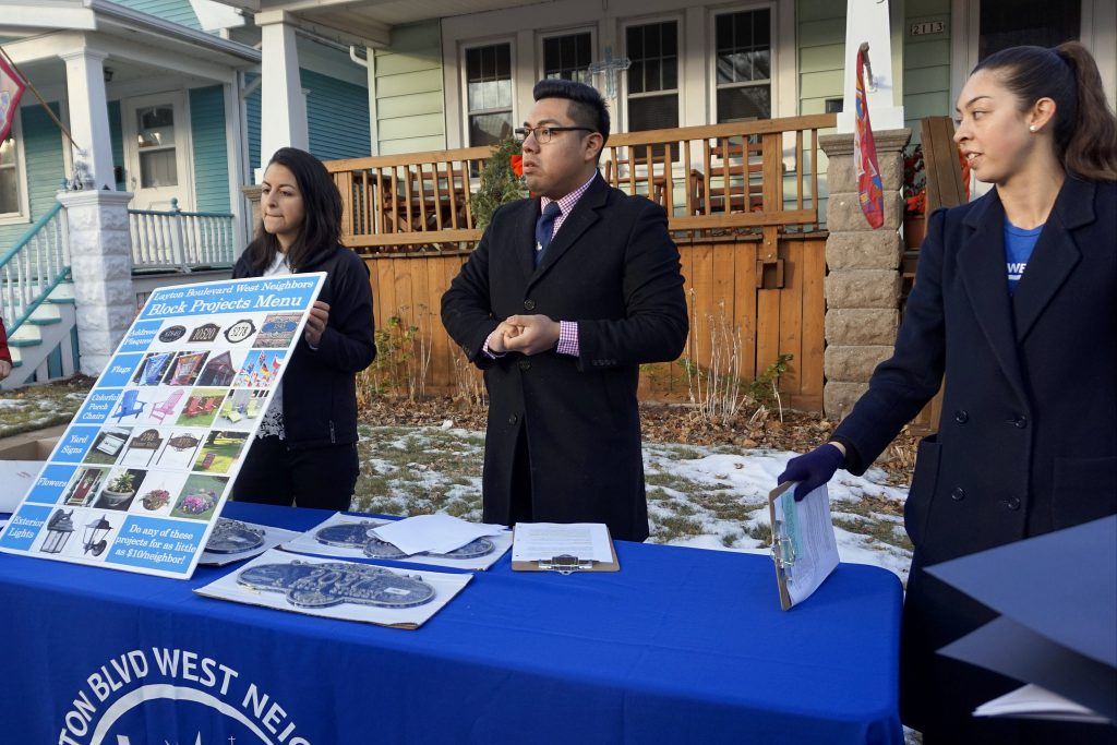 LBWN Executive Director Brianna Sas-Pérez and Community Outreach Managers Jonatan Zuñiga and Gisela Ortega talk about the Block Project Menu during an event in January. (Photo by Elizabeth Baker)