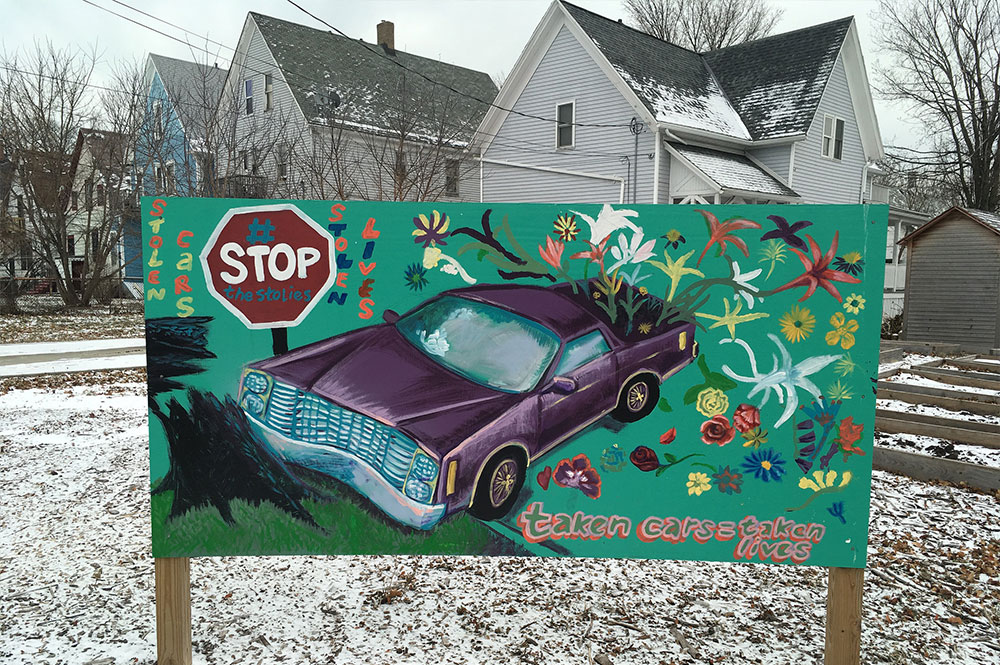 Artwork in Lindsay Heights warns passersby of the dangers of car theft and joyriding. Photo by Elliot Hughes.