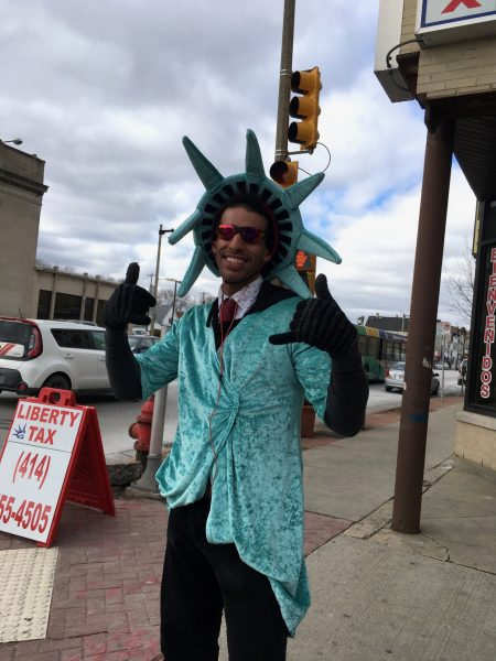 A man dressed as the Statue of Liberty dances outside a Liberty Tax Service outlet at 1336 S. Cesar E. Chavez Drive. Photo by Elliot Hughes.