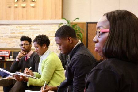 LaQuan McMahan (far left) listens to Tiffany Henry (foreground). Photo by Jabril Faraj.