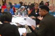Jarrett English of the ACLU facilitates a discussion with residents. Photo by Edgar Mendez.