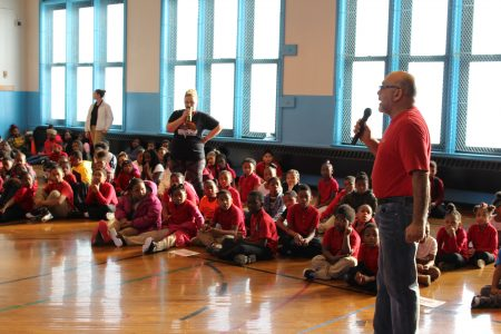 Chef Michael Feker addresses students at a pep rally honoring the work of Hot Healthy Breakfast Program volunteers. Photo by Mark Lisowski.