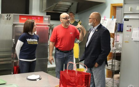 Chef Michael Feker (center) discusses how to integrate donated appliances into the Auer Avenue School kitchen with Noreen Noonan and Mark Sain. Photo by Mark Lisowski.