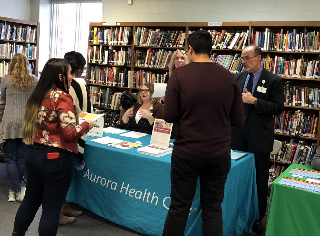 Reagan students interact with representatives from Aurora Health Care to learn about opportunities in healthcare. Photo courtesy of Marcy Aycock.