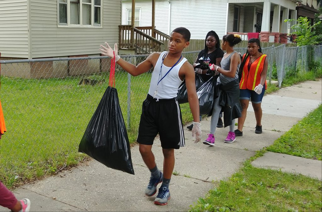 Metcalfe Park Young Cats, ages 10 to 13, were paid to clean up and beautify their neighborhood last summer. Small grants from the Greater Milwaukee, Zilber Family and Northwestern Mutual foundations funded the program. Photo courtesy of Metcalfe Park Community Bridges.