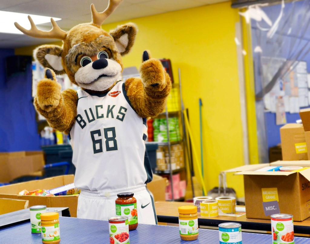 Milwaukee Bucks mascot Bango gives the thumbs-up during a Block Out Hunger campaign food sort at the Hunger Task Force's 201 S. Hawley Court location. Photo courtesy of Cousins Subs.