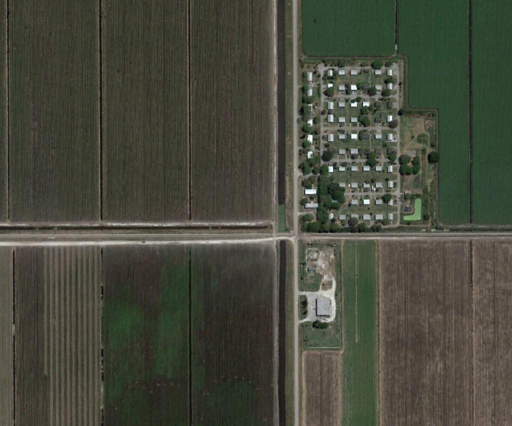 In Florida, where prohibitive residency restrictions have led to homelessness among sex offenders, some seek refuge in an isolated community in South Florida called Miracle Village, which is home to more than 100 people, most of them sex offenders. The group of houses is outside of Pahokee, in rural Palm Beach County, and is surrounded by sugar cane fields. Photo from Google Earth Pro.