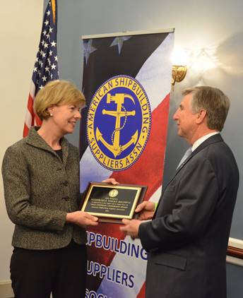 U.S. Senator Tammy Baldwin accepts the Honorable Thad Cochran Leadership Award from Chris Cikanovich, President of ASSA, on March 7, 2018. Photo from the Office of Senator Baldwin.