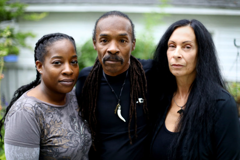 James Morgan is pictured with his wife Rachel and daughter Angela at his residence in Monona, Wis. Morgan, who spent 26 years in prison for sexual assault and other crimes, now wears a GPS ankle bracelet for life. He has been arrested several times due to GPS problems, most recently on July 4, 2017. Photo by Coburn Dukehart / Wisconsin Center for Investigative Journalism.