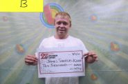 "James Shafer, from Eau Claire, Wis., poses with a check for $10,000 after cashing in a stolen winning ticket for Wisconsin's ""20X The Money"" scratch-off game. Justin Brummond, Shafer's brother, promised to pay him $500 for cashing the stolen ticket. The brothers and a store clerk were charged and convicted in connection with the theft. Photo from the Wisconsin Lottery."