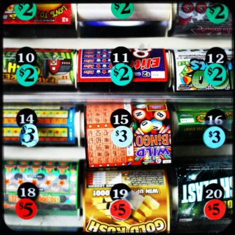 Lottery tickets are shown for sale in Stoughton, Wis. Wisconsin has no laws preventing retail lottery sellers or their employees or owners from buying and cashing in lottery tickets at their own stores — a gap in regulation that could open the state's lottery system to fraud. Photo by Coburn Dukehart / Wisconsin Center for Investigative Journalism.