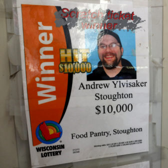 Andrew Ylvisaker, pictured here on a sign at the Food Pantry Citgo in Stoughton, Wis., has won numerous $1,000 prizes and one for $100,000 at the store. He also won $1 million at a Kwik Trip across town. Ylvisaker has won the Wisconsin lottery 28 times for a total of more than $1.1 million since 2007, lottery records show. Photo by Coburn Dukehart / Wisconsin Center for Investigative Journalism.