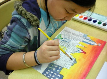 An MPS student uses watercolors in an art class taught by an Arts @ Large teacher. Photo courtesy of Arts @ Large.
