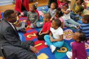 Milwaukee Public Schools Interim Superintendent Keith Posley talks with kindergartners Monday, at Clarke Street Elementary School. Chuck Quirmbach/WPR