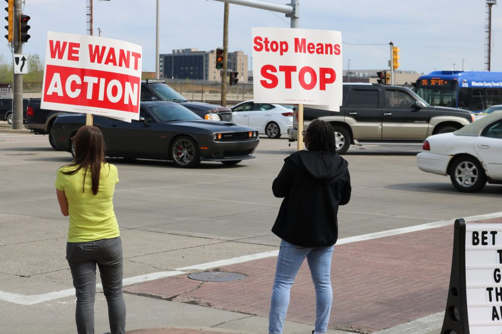 Community members stand at the intersection for hours at a time urging drivers to slow down and be safe. Photo by Sophie Bolich.