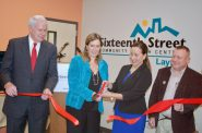 Dr. Julie Schuller (center left), Sixteenth Street CEO, and Cristy Garcia-Thomas, Aurora Health Care chief external affairs officer, mark the ceremonial opening of the Layton Clinic, as Mayor Tom Barrett (left); and state Rep. Josh Zepnick (right) look on. Photo by Andrea Waxman.