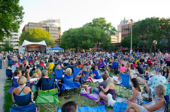 Cathedral Square Park is full of people enjoying Jazz in the Park. Photo by Melissa Miller.