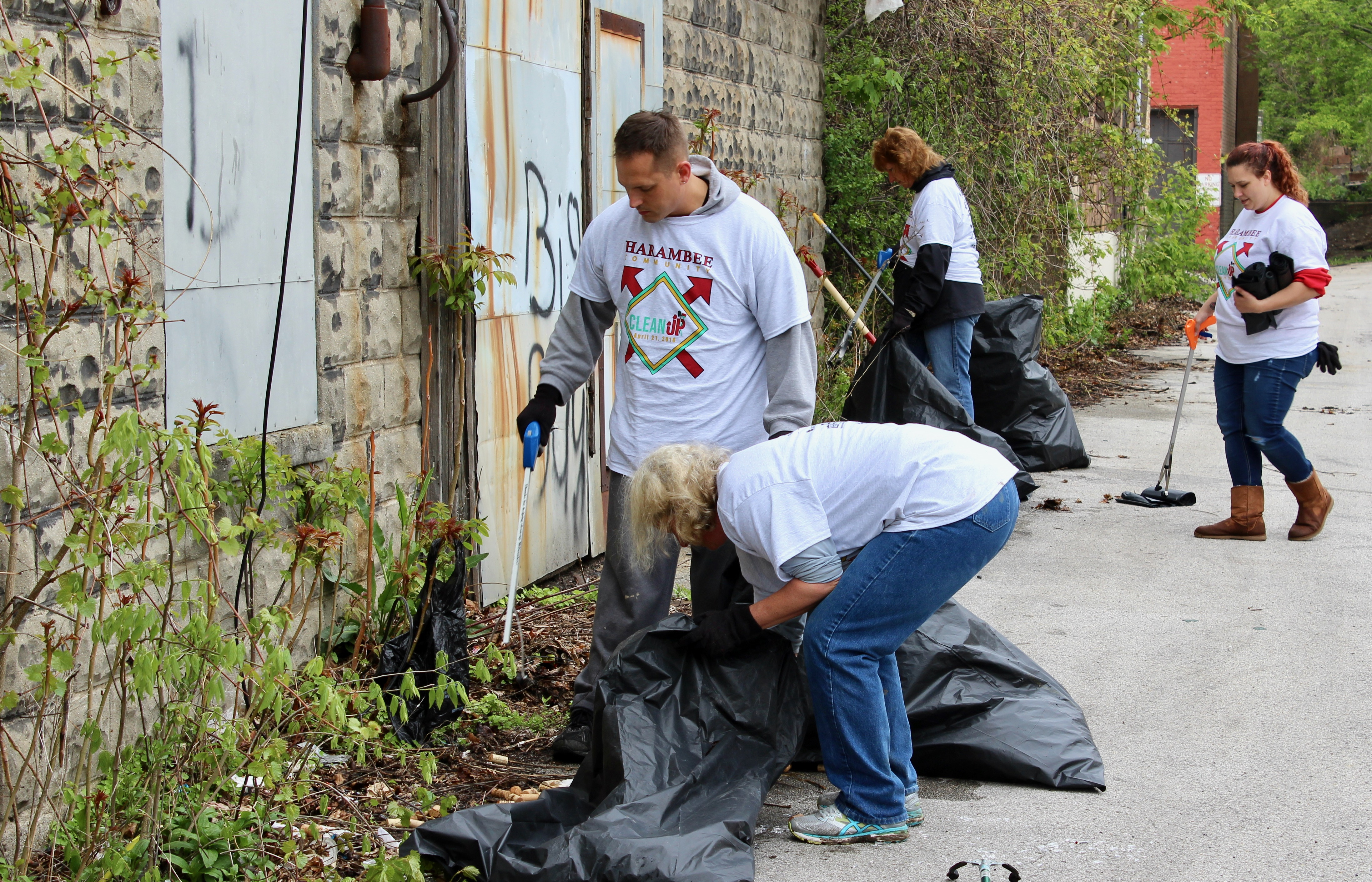 Massive harambee neighborhood cleanup urban milwaukee volunteers scoop debris including an abandoned collection of wine corks into trash bags behind malvernweather Image collections