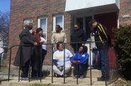 Metcalfe Park Community Bridges members gather at the vacant building being considered as a residential assessment center for youth taken from their homes for their protection. Photo by Andrea Waxman.