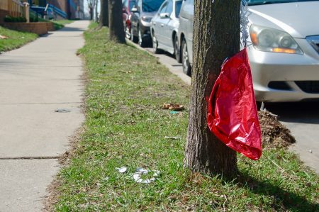 A memorial for the victims of a double homicide that occurred on the 1900 block of South 11th Street on April 14. Photo by Edgar Mendez.