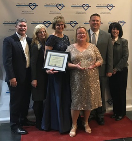 Accepting the 2018 Safety Net Urban Partner of the Year award are Froedtert Health representatives (l to r): Rock Evenson, vice president of business operations; Kerry Freiberg, vice president of community engagement; Angie Palese, nurse practitioner at COHC; Linda Smith, nurse practitioner at COHC; Andy Dresang, director of community engagement; and Diane Ehn, vice president of post-acute care strategy and partnerships. Photo courtesy of the Froedtert & the Medical College of Wisconsin.